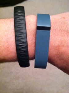 Jawbone UP on left, Fitbit Flex on right.